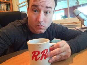 Poet Rick Lupert drinks coffee.
